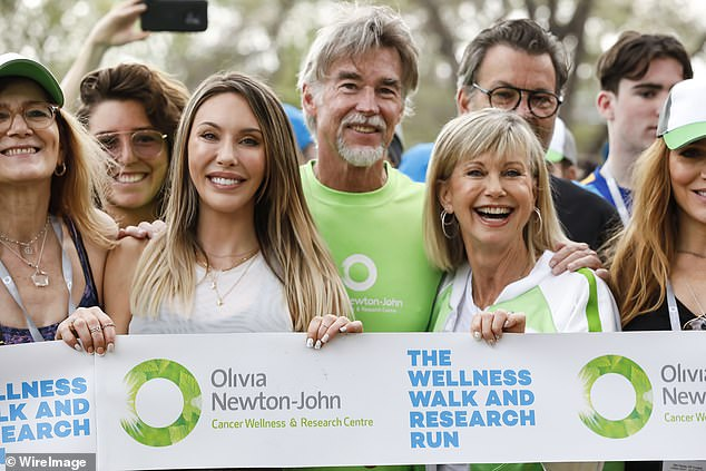 She's a fighter! Speaking during the Wellness Walk and Research Run in Melbourne in October (pictured), the actress told the gathered crowd: 'I'm right here, right now, alive and healthy'