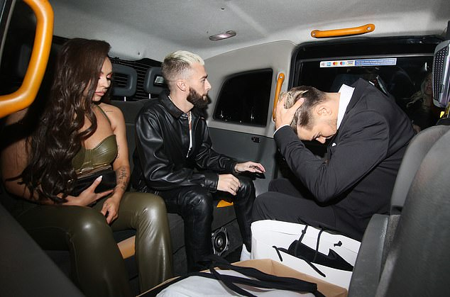 Regrets? The ex Love Island star appeared to calm down from his scuffle as he put his head in his hands and joined girlfriend Jesy, 28, and her stylist Jamie in the taxi after his outburst