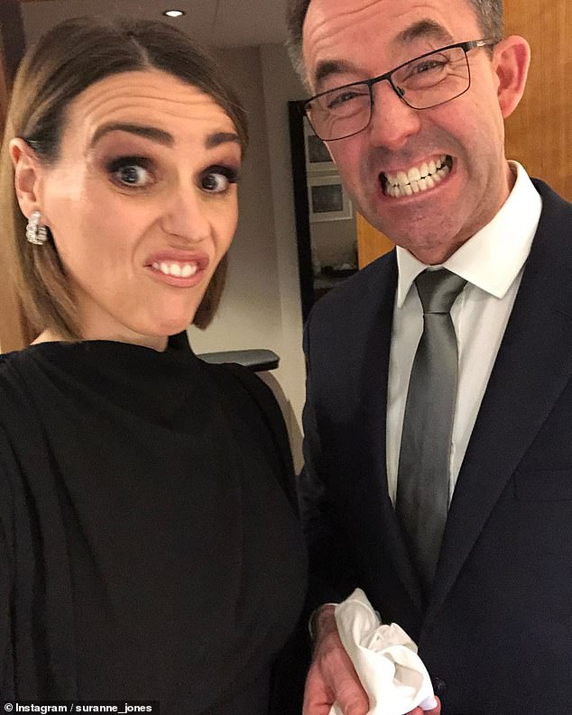 Backstage banter: Suranne Jones and husband Laurence Akers struck comical poses before the awards