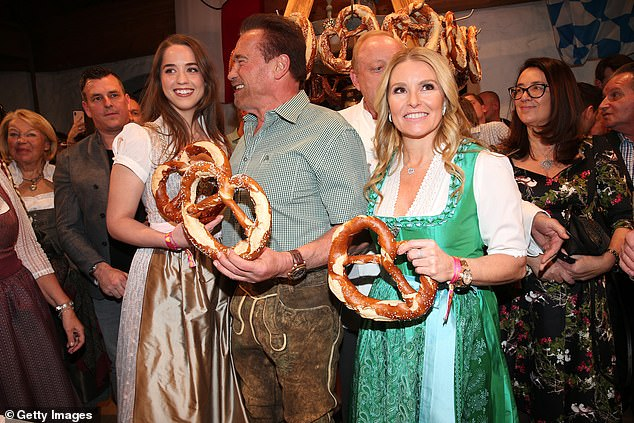 Traditional dress:Meanwhile Heather, 45, also got into the spirit of things as she also wore a classic Bavarian ensemble in a fetching green shade