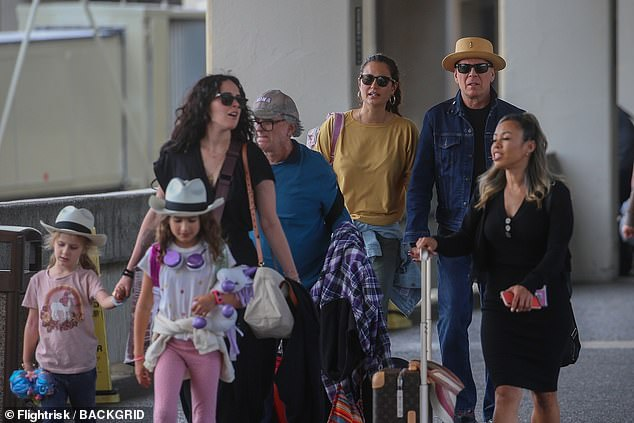 Family affair! Bruce was seen with his wife Emma, 41, and his kids, Rumer, 31, Mabel, seven, and Evelyn, five, at the airport