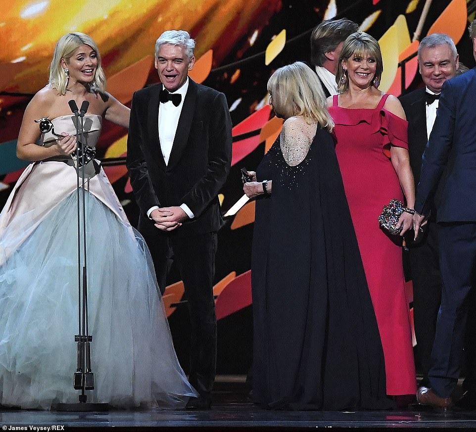 #awks? Presenters Holly and Phil accepted the gong next to Ruth Langsford and Eamonn Holmes, who are said to be in the midst of a major feud with Phil