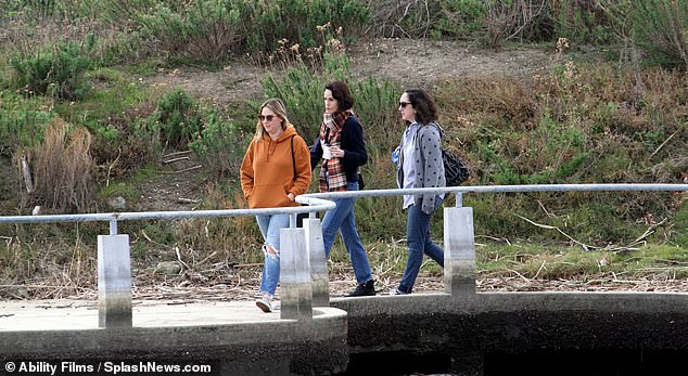 Walk: Michelle looked relaxed as she enjoyed the day with friends