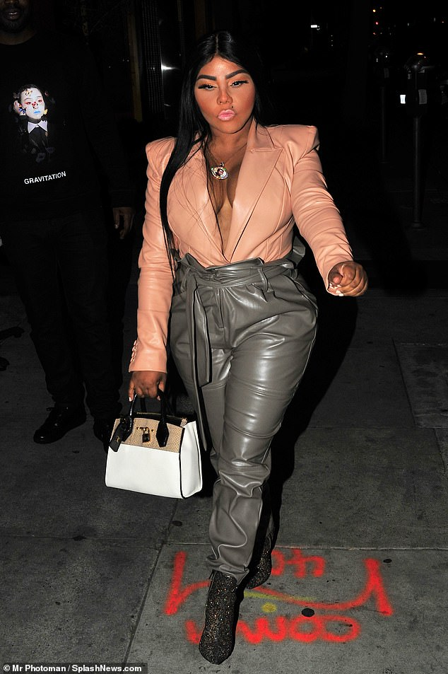 All leather-look: Lil' Kim, 45, looked on her game as she stepped out for dinner with friends at popular West Hollywood celeb haunt Craig's on Thursday