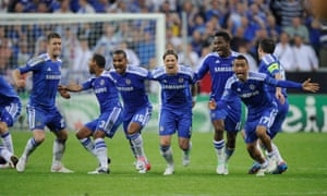 Chelsea react to Didier Drogba's winning penalty.