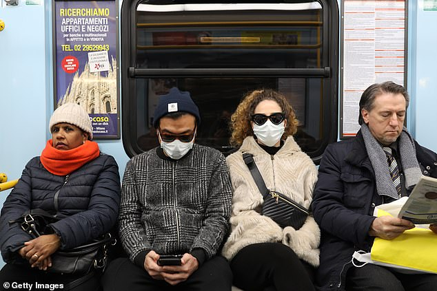 Officials have notified 180 drug manufacturers to warn the FDA if they anticipate delays in getting their products to the US. Pictured: Passengers on a subway in Milan wear masks, February 26