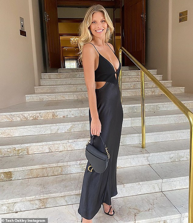 Gorgeous: Natasha shared only solo shots of herself at the wedding venue to Instagram (pictured), where she showed off her figure in a plunging black silk frock with cut-out detail