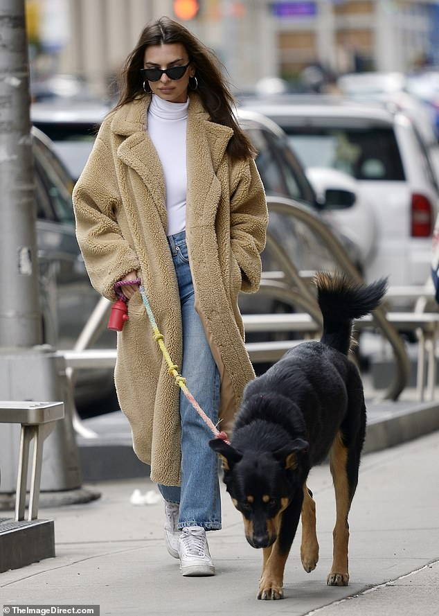 Bundled up:Emily's timeless look consisted of a warm, teddy-bear coat with boot-cut mom jeans and a tight white bodysuit underneath