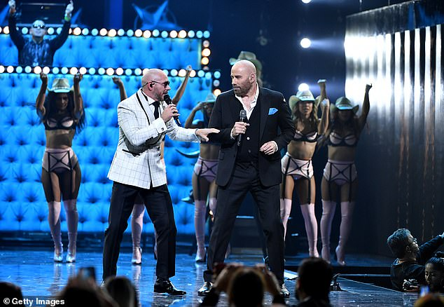 Rock it: Also at the event were Pitbull and John Travolta who performed together on stage
