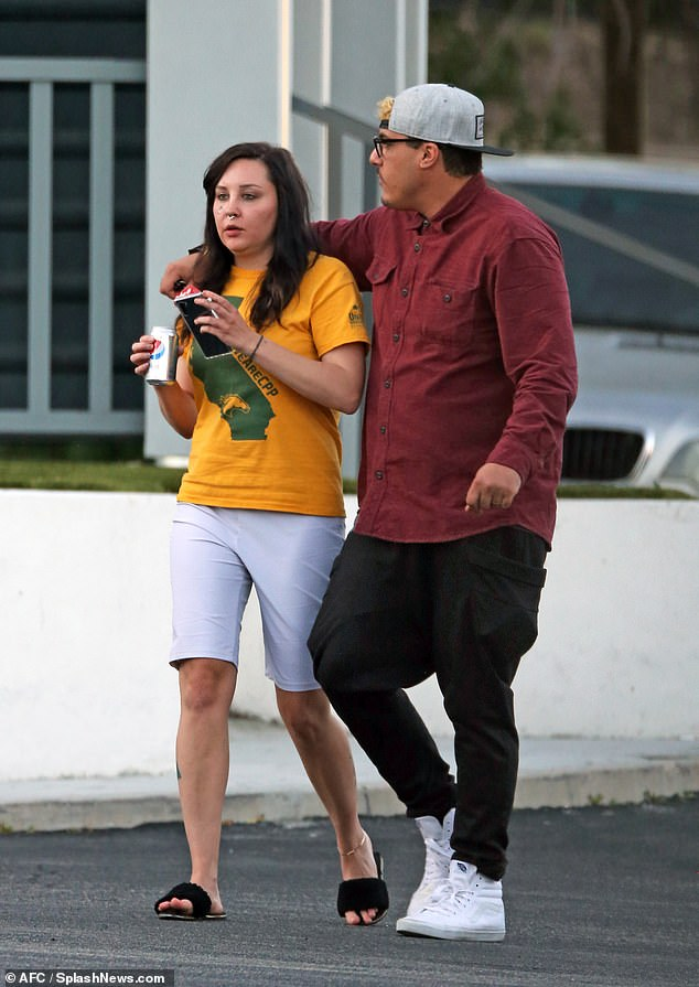 Amorous: Paul, who is reportedly the son of a prominent LA doctor - couldn't keep his hands of the Easy A star