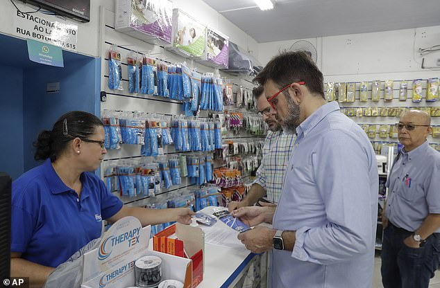 He adds that he believe the coronavius outbreak too will run its course but, in the meantime, he recommends staying vigilant. Pictured: Customers buy masks at a medical supply store in Sao Paulo, Brazil, February 26