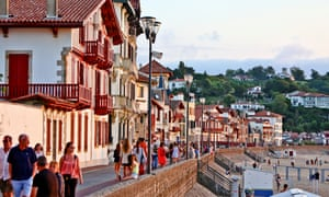 People in sunshine on  seafront at Saint-Jean-de-Luz