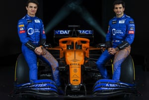 Lando Norris, left, and Carlos Sainz, with the 2020 McLaren