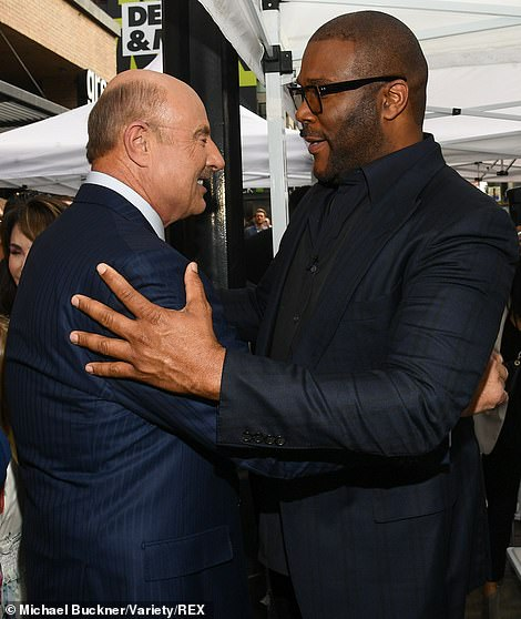 Hug it out: Dr. Phil thanked Perry and Dunn for their kind words after the ceremony