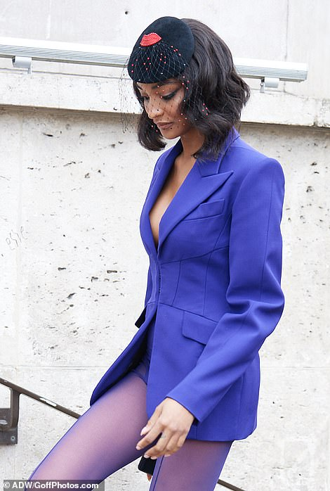 Wow!Jourdan Dunn wore a funky purple ensemble complete with a blazer and tights