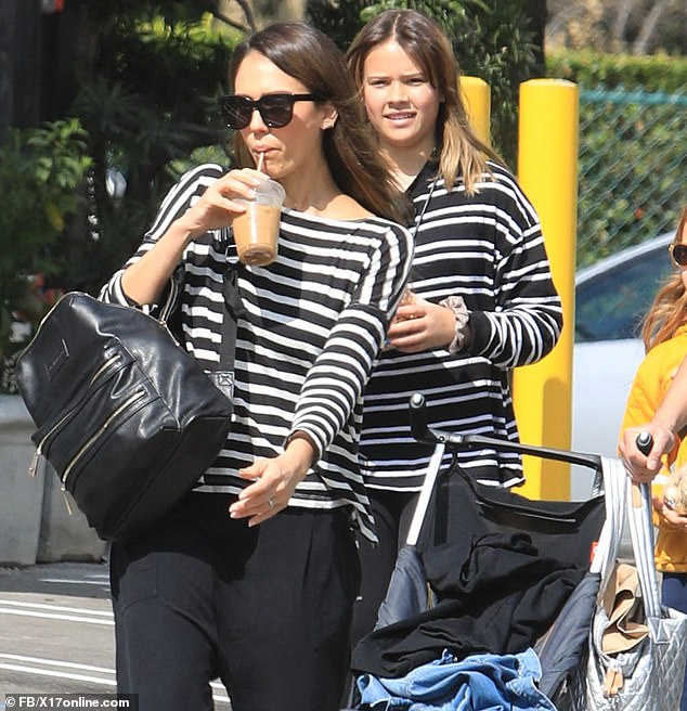 So sweet:Jessica modeled an ultra-chic black and whited striped sweatshirt for her day out, matching her eldest daughter