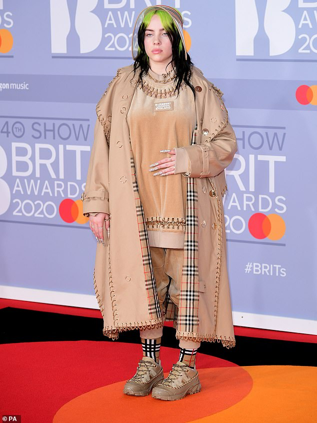 Bold look:The outlandish singer commanded attention in a distinctive Burberry ensemble as she walked the red carpet at London's O2 Arena