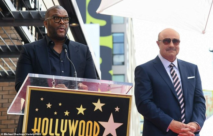 Famous friends: Hollywood mogul Tyler Perry also took to the microphone to praise Dr. Phil