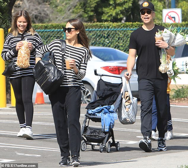 A place in the sun:The 38-year-old actress and consumer goods mogul stepped out with her dashing husband Cash Warren and their children