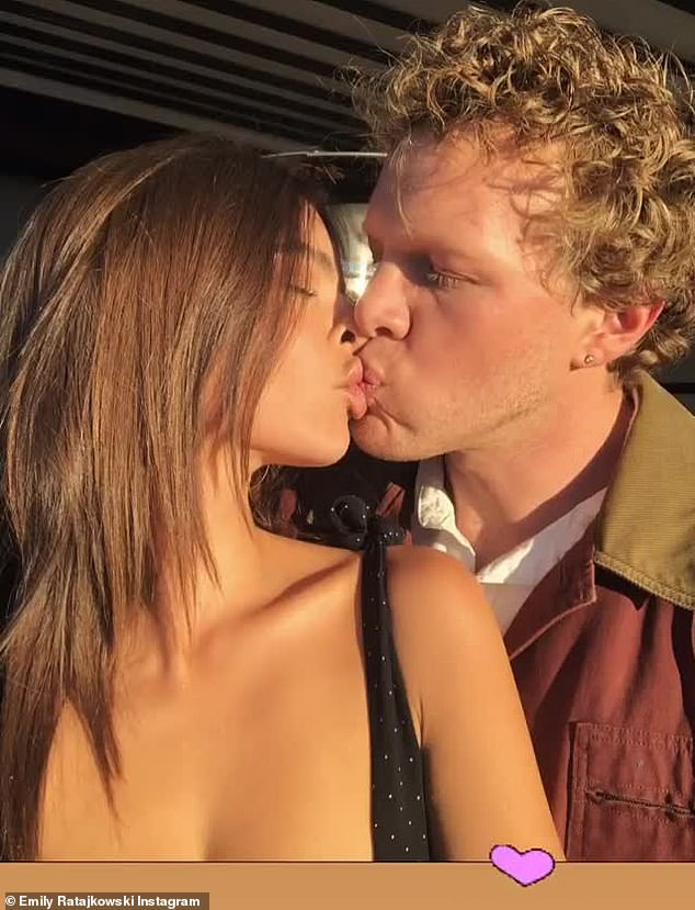 Pucker up:Love is still very much in the air for the supermodel and her movie producer and artist husband of two years Sebastian Bear-McClard