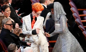 Janelle Monáe signing Sandy Powell's outfit at the Oscars