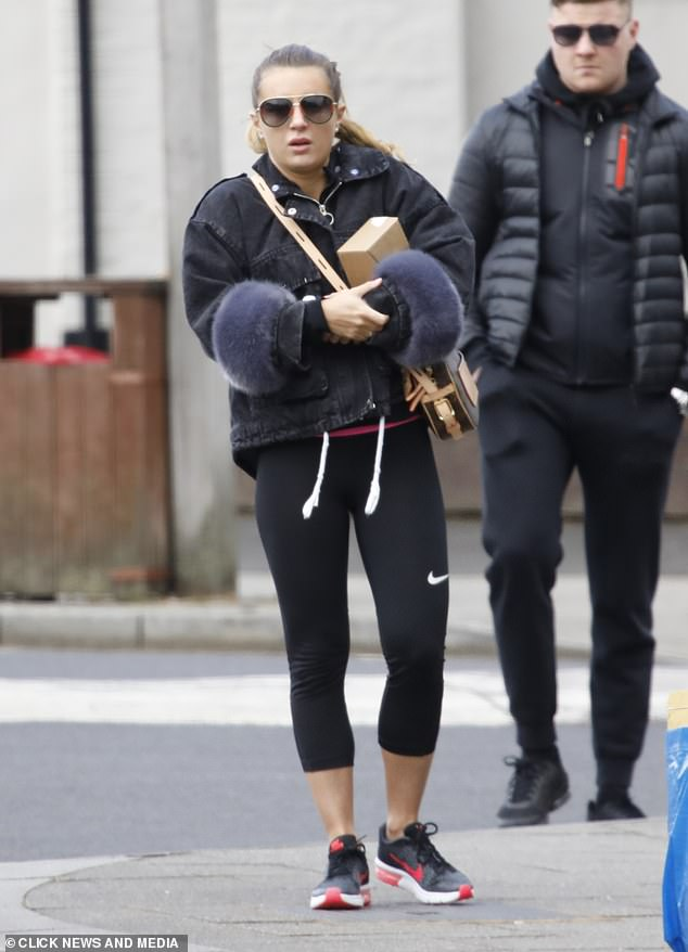Stamp duty: Dani Dyer headed to the post office in workout gear on Monday as she enjoyed her daily outing amid the coronavirus lockdown