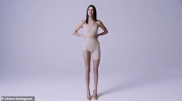 Nude look:Vogue supermodel Kendall had on a beige bra top and a pair of bottoms that had one leg exposed; these are used for a skirt that has a high slit