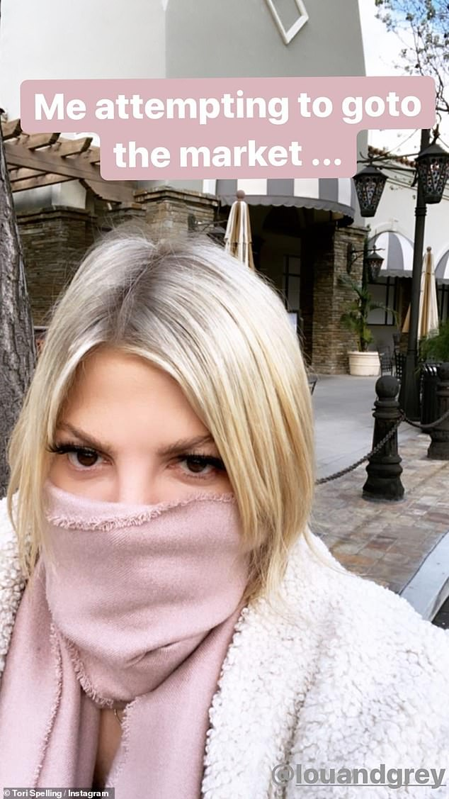 Do not breathe: Tori Spelling stepped out for some Sunday grocery shopping, but not without keeping her mouth and nose covered