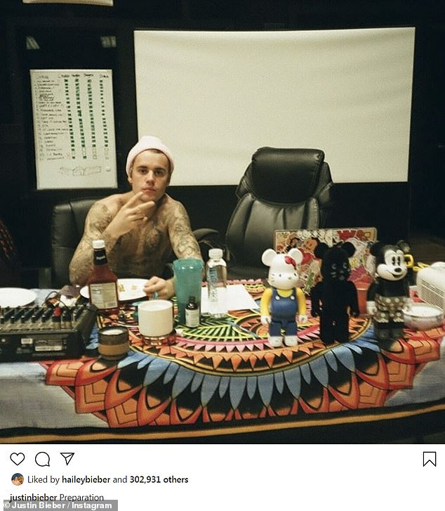 He is ready: 'Preparation,' captioned Justin Bieber who shared a strange photo of himself flashing a piece sign, while an array of non-essential items stood before him