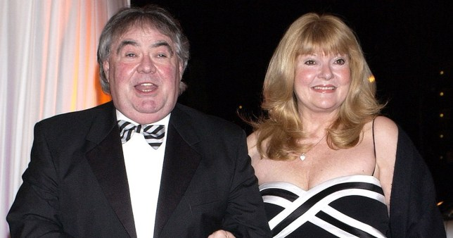 File photo dated 09/03/04 of comedian Eddie Large with wife, Patsy Ann Scott, at the Bob Monkhouse BAFTA Tribute at BBC Television Centre in West London. Eddie Large, best known as part of the double act Little and Large, with Syd Little, has died aged 78. PA Photo. Issue date: Thursday April 2, 2020. See PA story DEATH Large. Photo credit should read: Yui Mok/PA Wire