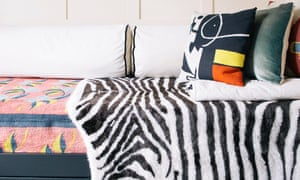 A faux-fur zebra throw and cushions