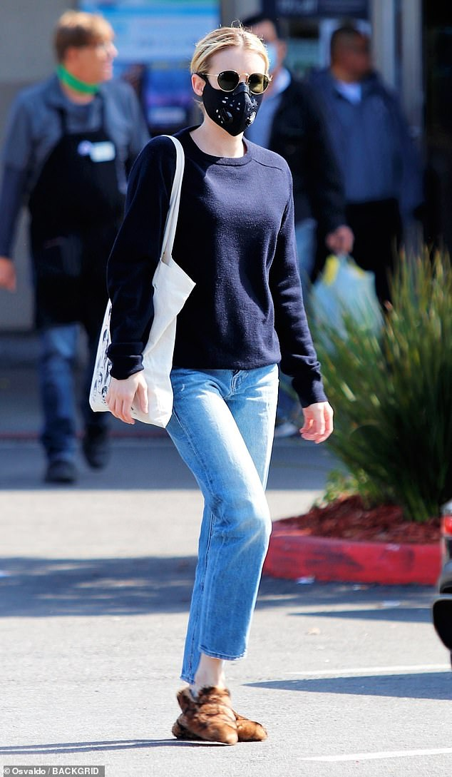 The American Horror Story actress, 29, wore a protective mask and dark sunglasses when she arrived at a grocery store in the Los Feliz neighborhood of LA