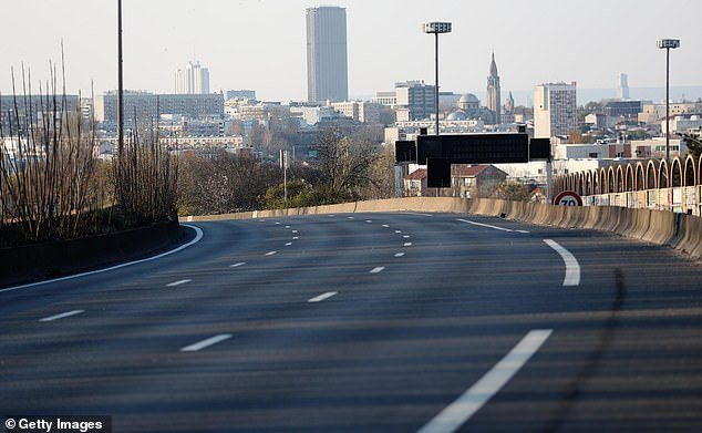 The freeway A6 south of Paris which arrives on the French capital and the Montparnasse tower is empty of all traffic due to confinement because of the coronavirus