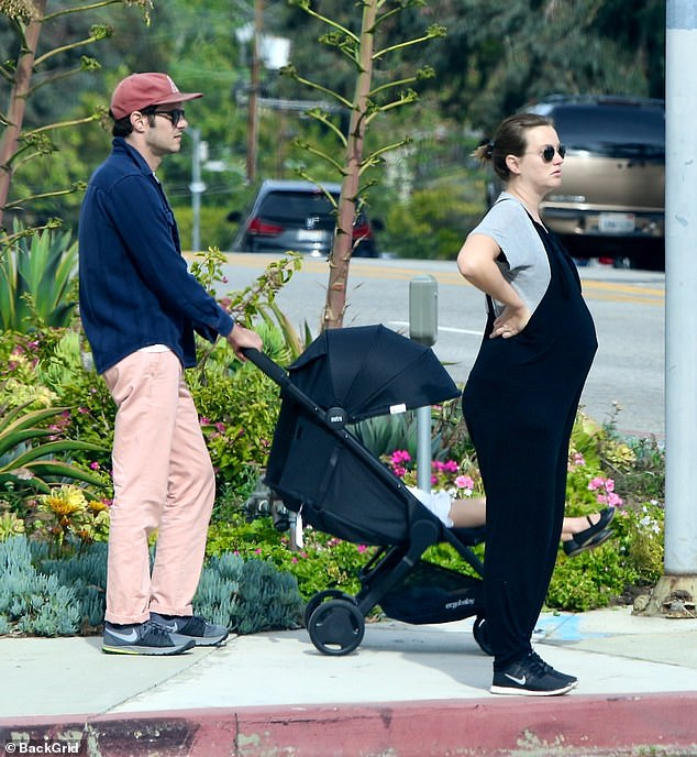Family day:The Gossip Girl vet was in a pair of black overalls as she was with her husband Adam Brody of The OC fame. Together the lovebirds who wed in 2014 already have daughter Arlo Day Brody, aged four, who was seen in a stroller