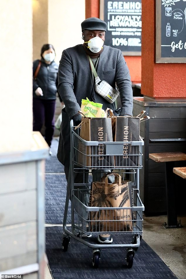 Safety first: will.i.am wore a medical grade facemask and gloves as he stocked up on essentials at Erewhon in Los Angeles, California, on Thursday