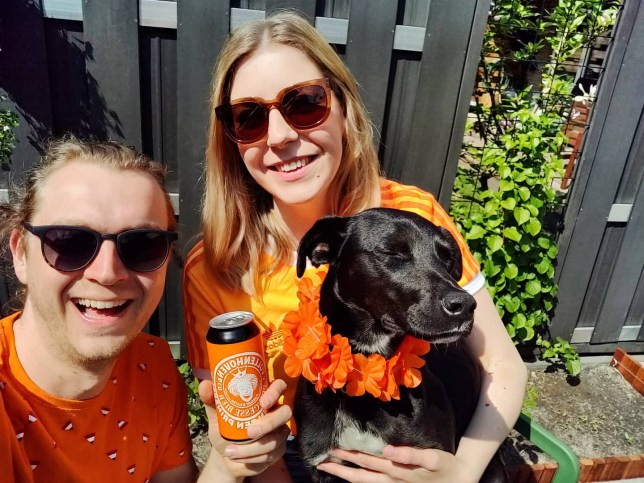 Lily Howes posing with a friend and her dog in the sunshine