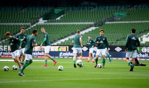 The Bremen players warm up at Wohninvest Weserstadion.