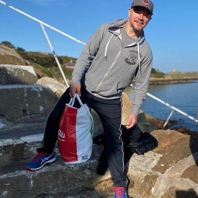 At the beach: The tickled star also weighed in on rumours that he was carrying beers in a bag from a local supermarket when he was snapped by a fan (pictured at the beach in Dalkey)