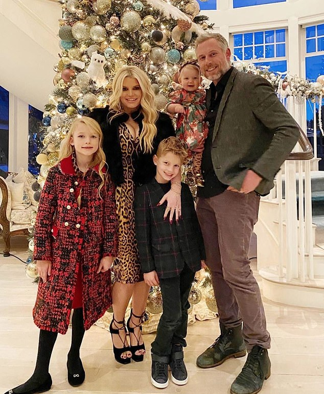 Work and family: Jessica's tome, titled Open Book, hit shelves in February to positive reviews and healthy sales; seen here with the whole family at home