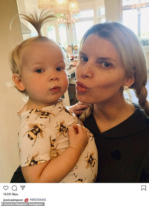 Funny natural faces: Simpson yet again proved to be the natural beauty that she is in another stunning Instagram selfie, this time holding up her angelic baby girl