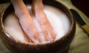 Feet soaking in soapy water