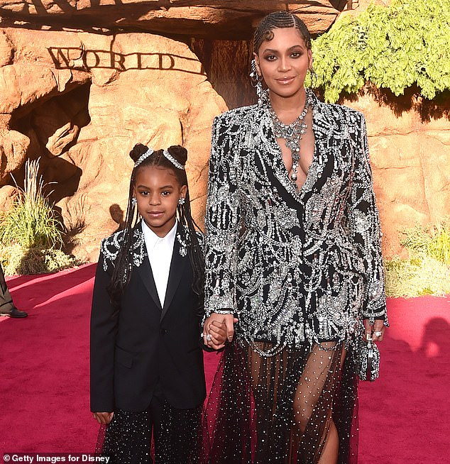 Winner! Beyonce's daughter Blue Ivy Carter won a BET Award for her and her mom's song Brown Skin Girl. The duo are seen in July 2019 above