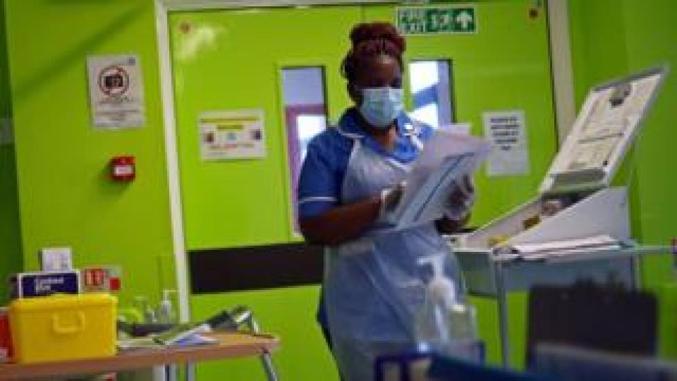 Nurse Princess Kavanire wearing a protective face mask, works on Ward D1 at the Royal Blackburn Teaching Hospital in Blackburn, north-west England on May 14, 2020