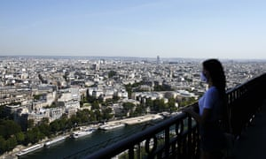 A visitor looks at the view from the Eiffel Tower