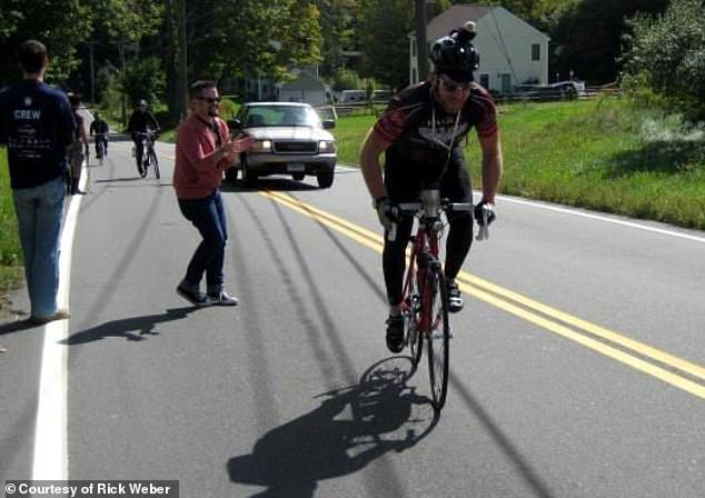 The father-of-two his spending his first Father's Day in years feeling healthy and wants to eventually cycle again. Pictured: Weber participating in the Northeast AIDS Bike Ride before his illness