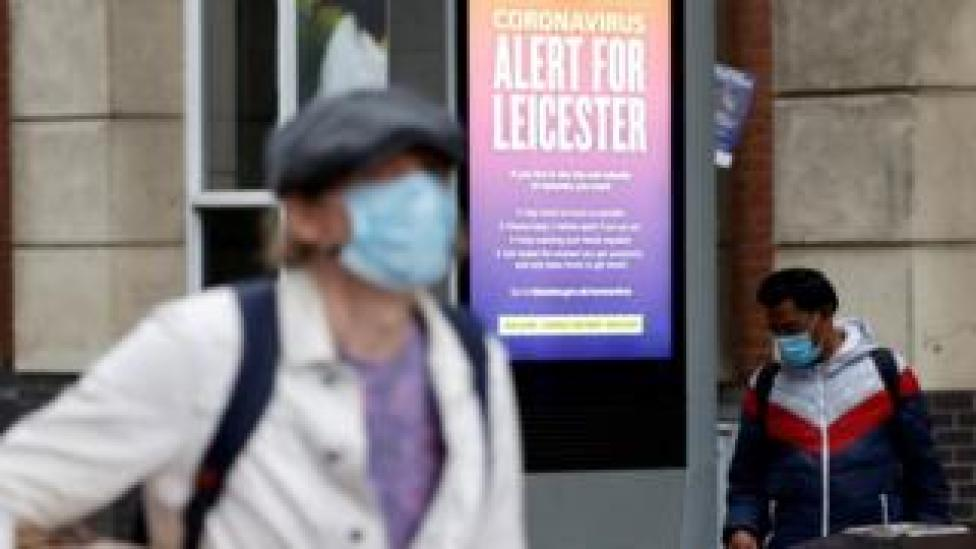 An NHS alert message is seen on a street in Leicester