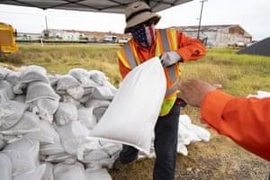 Employees with the City of Corpus Christi load sandbags in to peoples cars as Tropical Storm Hanna approaches on 24 July 2020, in Corpus Christi, Texas.