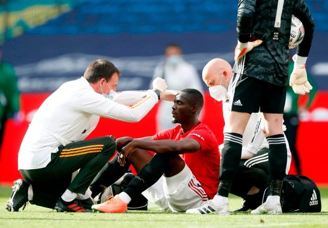 Manchester United's Ivorian defender Eric Bailly receives treatment after clashing heads with Chelsea's French defender Kurt Zouma during a challenge during the English FA Cup semi-final football match between Manchester United and Chelsea at Wembley Stadium in London, on July 19, 2020. (Photo by Alastair Grant / POOL / AFP) / NOT FOR MARKETING OR ADVERTISING USE / RESTRICTED TO EDITORIAL USE (Photo by ALASTAIR GRANT/POOL/AFP via Getty Images)