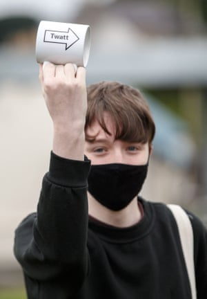 """A protester holds up a mug with """"Twatt"""" written on it (the name of a small town in Orkney), marking Boris Johnson's visit."""