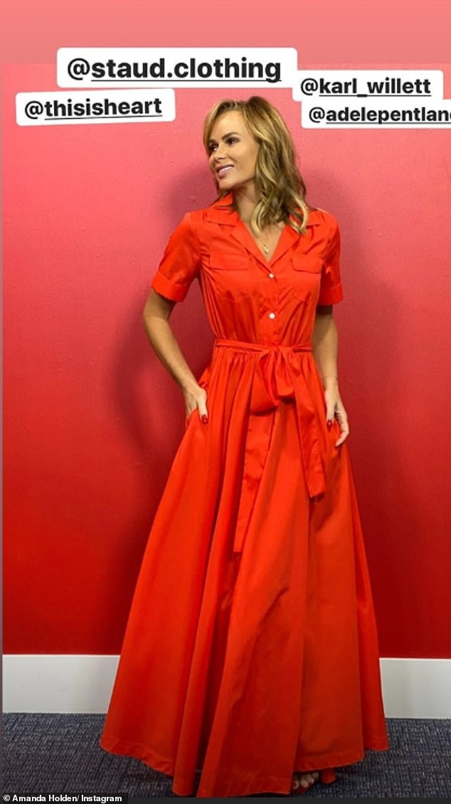 Summer chic: 'I'm gonna leave the captions up to you ..♥️,' Amanda captioned the fun video, before posing for a chic outfit photo in front of the Heart studio's matching red wall